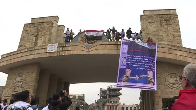 In Eastern Mosul, students are returning to their university. Now recaptured from the Islamic State group, dozens of students and youth movements gather on campus to rise the Iraqi flag once more. Video provided by AFP