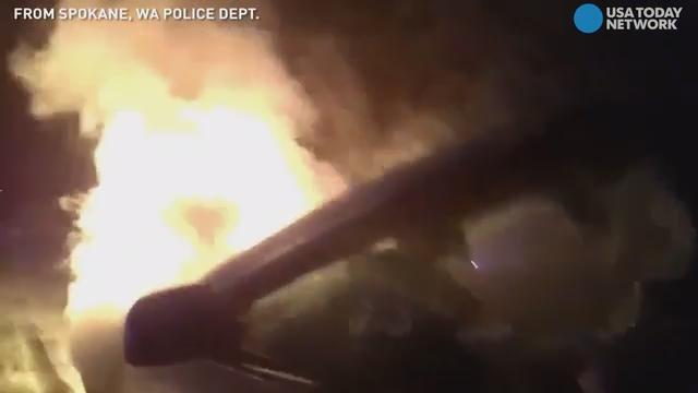 A Spokane, Washington police officer saved a woman from her burning car, and it was all caught on camera.