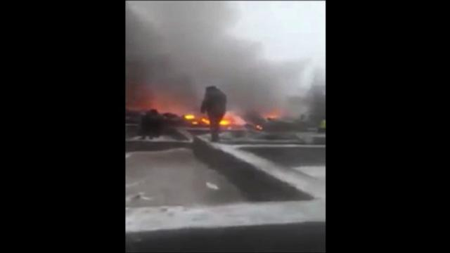 A Turkish cargo plane crashes into a village near Kyrgyzstan's main airport, killing dozens of people and destroying houses after attempting to land in thick fog, according to authorities. Video provided by AFP