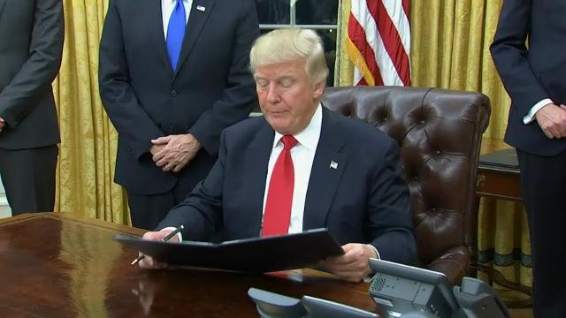 President Donald Trump signed his first executive order as president, ordering federal agencies to ease the burden of President Barack Obama's sweeping health care law. Retired Gen. James Mattis took the oath of office to be defense secretary. (Jan. 20)