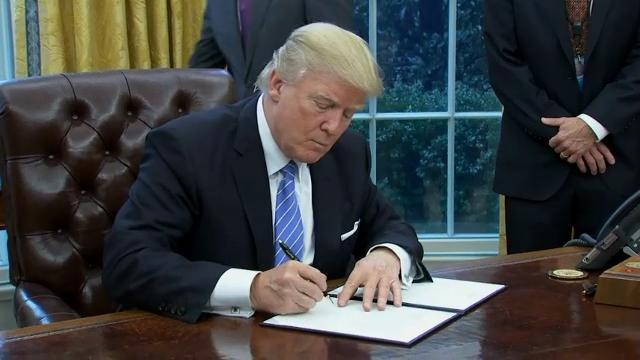 President Donald Trump signed multiple executive orders in the Oval Office Monday including a memorandum to leave the proposed Pacific Rim trade pact known as the Trans-Pacific Partnership. (Jan. 23)