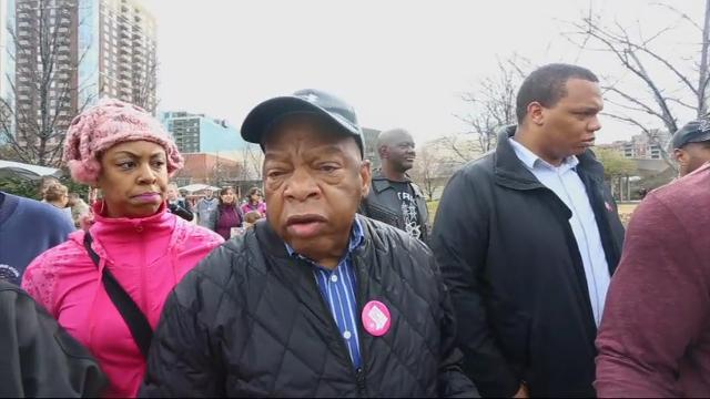 Democratic Congressman John Lewis of Georgia joined an estimated 60,000 who marched in Atlanta on Saturday. The marchers, along with people demonstrating across the nation, protested President Donald Trump's policies and statements. (Jan. 22)