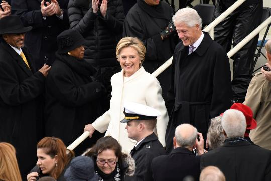The two former presidents and first ladies arrive at the swearing-in ceremony.