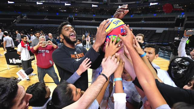 Members of the Suns and Mavericks spent time teaching basketball to a group of kids in Mexico City. It resulted in a lot of smiles and high fives.