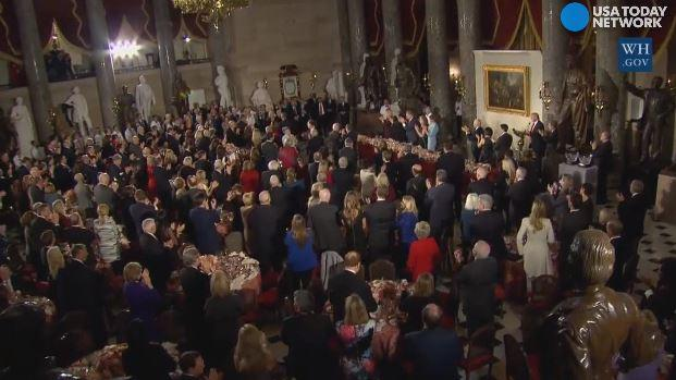 In a luncheon following his inauguration, Donald Trump led the room in a standing ovation to honor Hillary Clinton.
