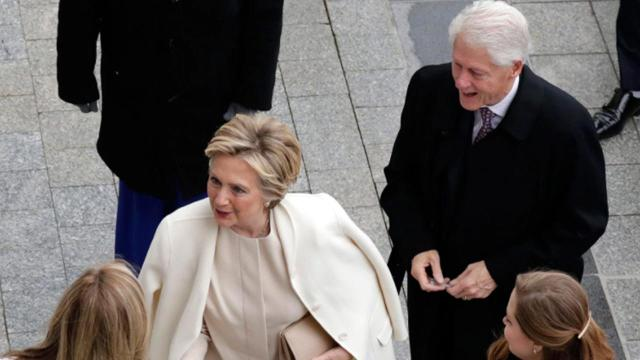 After fighting a bitter and often personal battle during last year's bruising presidential election, Hillary Clinton arrived for Donald Trump's swearing-in ceremony in Washington, D.C. Friday alongside her husband, former President Bill Clinton, and their daughter, Chelsea Clinton