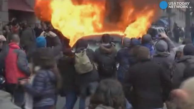 Protesters in Washington vandalized and set a limo on fire blocks away from the inaugural parade as protesters clashed with police.