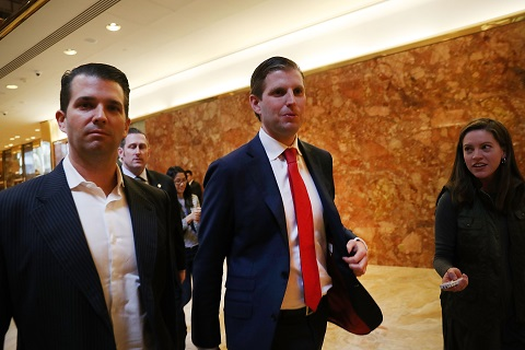 Donald Trump signs over family business to sons
