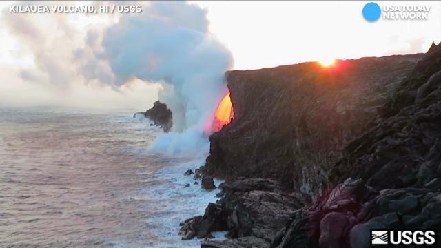 Lava flows like fiery waterfall from Hawaii volcano