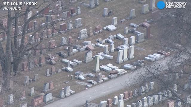 Vandals damaged dozens of headstones at a Jewish cemetery in St. Louis. Police will not yet say whether they are considering this a hate crime.