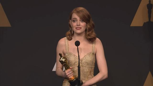 Backstage after winning her first Oscar, Emma Stone joked about a creepy moment she had with her coveted statue. (Feb. 27)