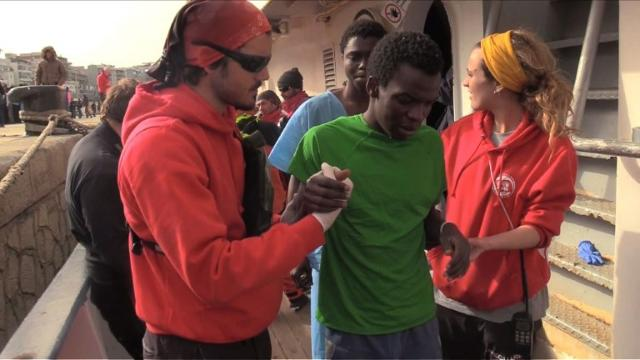The Spanish NGO 'Proactiva Open Arms' recues 324 migrants off the coast of Italy and brings them to the Sicilian port of Reggio Calabria.