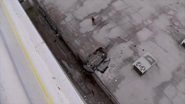 A car crashed off a parking garage in Houston Sunday afternoon falling seven stories onto the roof of another building. The driver described as a young man, was taken to the hospital in stable condition. (Feb. 27)