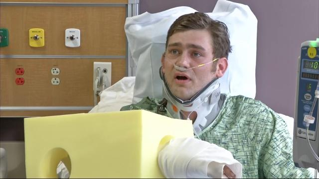 A man is charged with murder and attempted murder, for allegedly opening fire in a bar outside Kansas City. One person was killed and two were wounded. Ian Grillot, who survived the shooting, described what happened from his hospital bed. (Feb. 24)