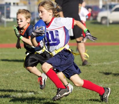 Elly loves to play football. She recently won the NFL's Punt, Pass and Kick competition, breaking a record in her age division.
