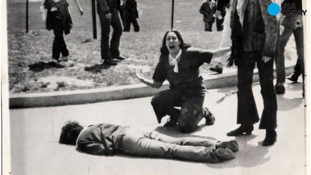 Mary Ann Vecchio, kneels over a 20-year-old student