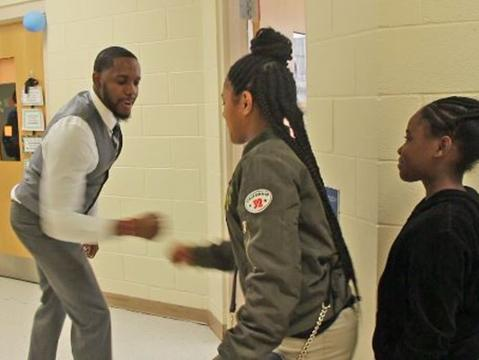 This teacher has different handshakes with each student