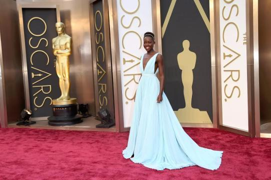 Celebs shine through Oscars fabulous fashion history