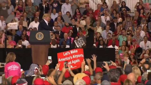 President Donald Trump on Saturday invited a supporter onstage while he was speaking at a campaign-style rally at Orlando Melbourne International Airport in Florida. (Feb. 18)