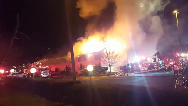 A fire swept through a hotel in Vineland, New Jersey, and a police officer is one of two people injured in the overnight blaze. (Feb. 24)