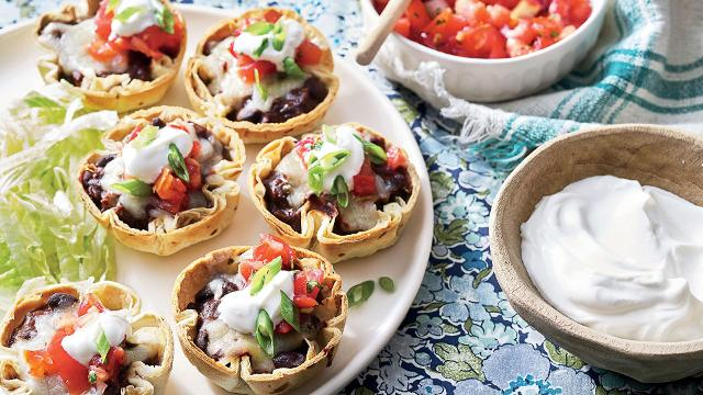 Enchiladas are a delicious comfort food, but they're a little too labor-intensive for busy weeknights. This handheld version is a fantastic twist on the recipe made with black beans, refried beans, enchilada sauce, and mini tortilla shells.