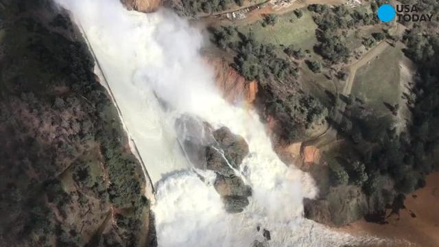 See water gushing out of the Oroville Dam from the air
