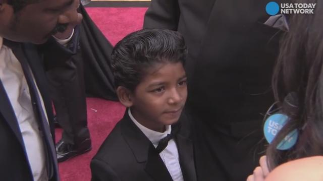 USA TODAY's Andrea Mandell chats with 8-year-old Sunny Pawar on the Oscars red carpet. The adorable 'Lion' actor chats about what life was like on set with Dev Patel.