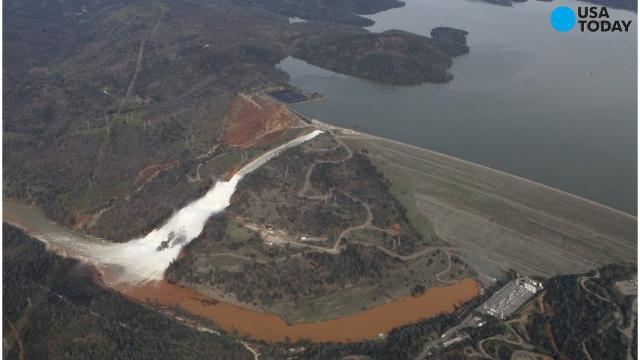 Chopper flies over damaged spillway at Oroville Dam