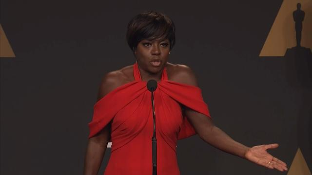Backstage at the Oscars, Viola Davis got emotional talking about growing up in poverty to become an Academy Award-winner. (Feb. 27)