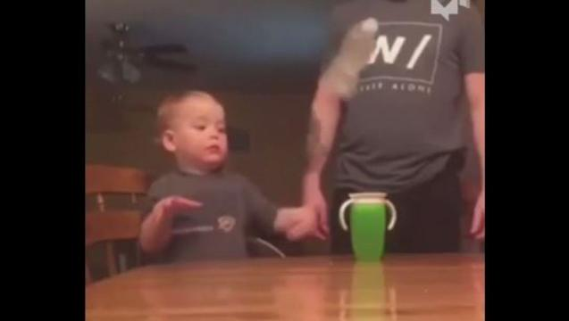 Child prodigy in the art of flipping bottles