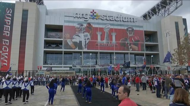 Raw: Fans Arrive to NRG for Super Bowl LI