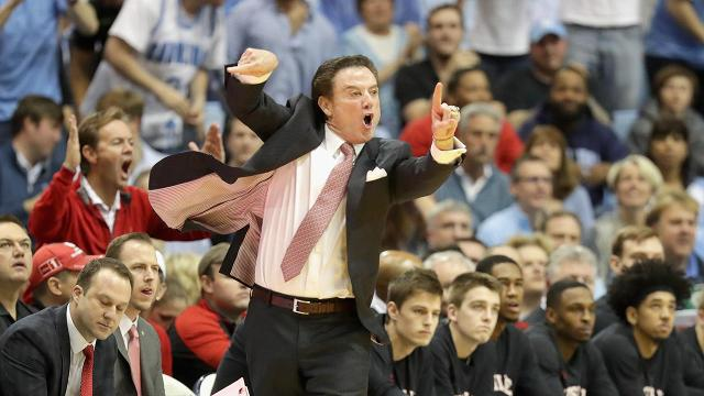 Lousiville head coach Rick Pitino had to be restrained from going after a North Carolina as he worked off the court for halftime during the Top 10 matchup on Wednesday.