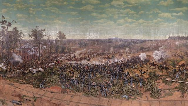 A crane lifts a panoramic painting depicting the Battle