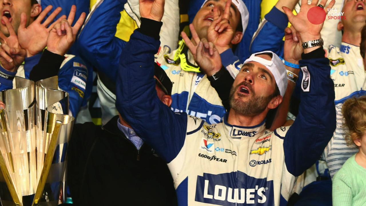 Team owner Rick Hendrick embraces Jimmie Johnson after