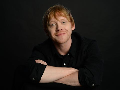 Rupert Grint compares playing Harry Potter's best friend Ron Weasley to playing Adopf Hitler's best friend in the UK TV series 'Urban Myths.'