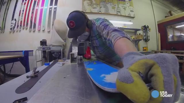 A Colorado company makes skis with custom photographs on top, by hand. Watch this days-long process in just one minute!