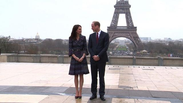 Britain's Prince William and his wife Kate play rugby with children in front of the Eiffel Tower during an official visit to Paris, months before the 20th anniversary of the death of William's mother Diana in a car crash in the French capital. Video provided by AFP