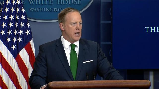 White House vows to appeal 'flawed' travel ban ruling