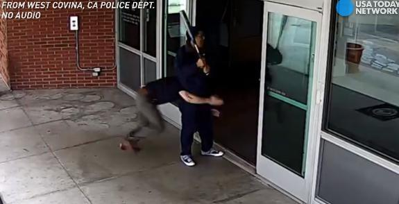 Cop tackles bat-wielding man outside police station