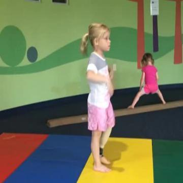 This girl does gymnastics with a prosthetic leg