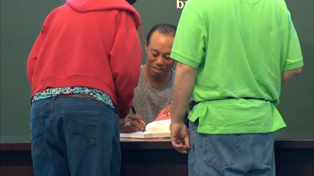Tiger Woods Signs His Book In NYC