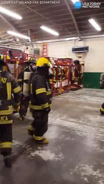 Firefighters play dodgeball in full gear