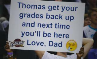 Dad savagely trolls son with bad grades sign at NBA games