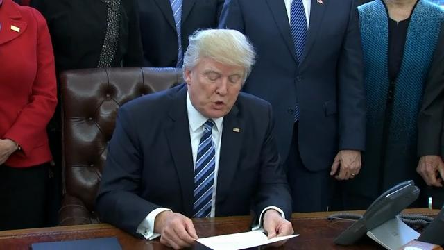 Trump signs order to streamline executive branch