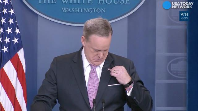 Spicer's flag pin fail: Call for help or fashion faux pas? #9F2C34