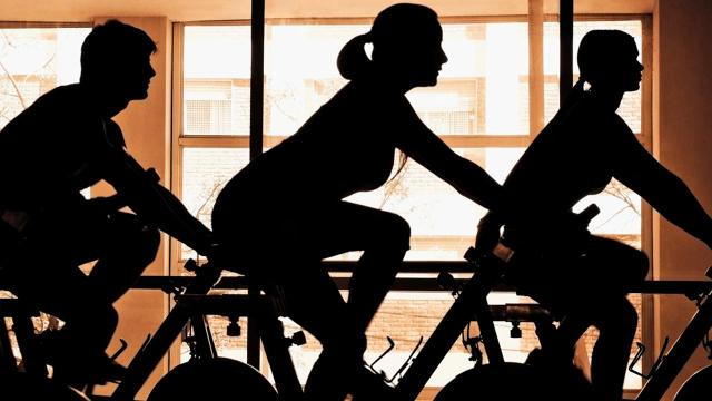 Spinning might look about the same as outdoor cycling or riding a stationary bike, but in many ways, it's a far more intense workout—and one of the easiest to overdo.