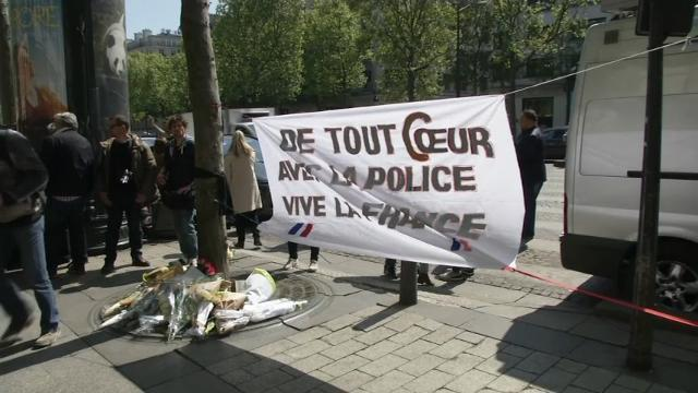 Raw: Memorial For Officer Killed In Paris Shooting