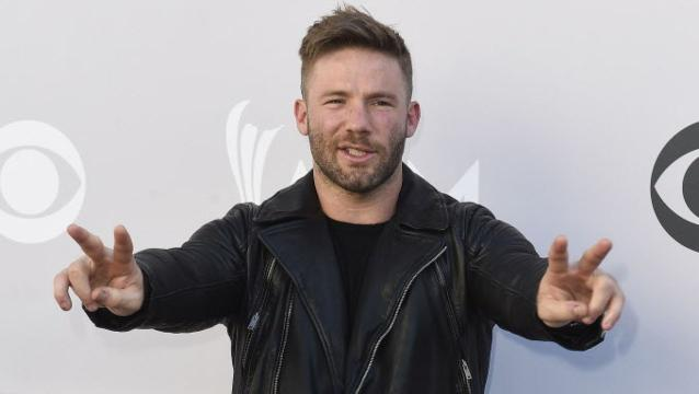 Watch Julian Edelman ride in an IndyCar with Mario Andretti
