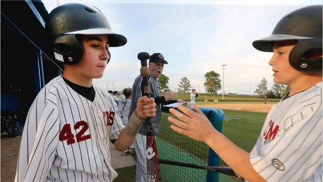 One-armed catcher excels on baseball diamond