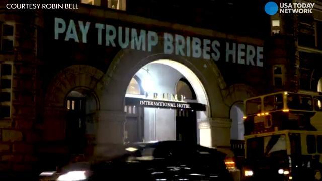 Artist projects 'Pay Trump bribes here' onto Trump hotel